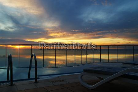 ferie solnedgang aften undergang aftenrode spejling