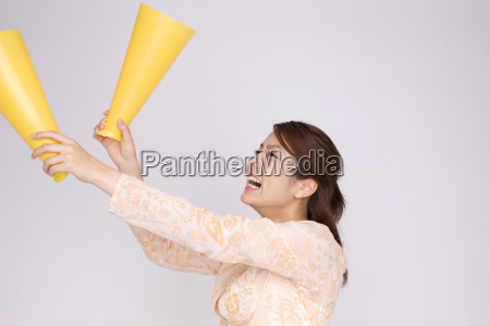japanese young woman cheering with megaphones
