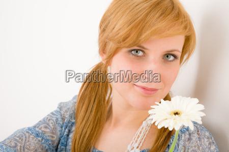 romantic young woman hold gerbera daisy