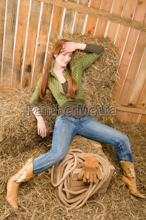 provocative position young cowgirl on hay