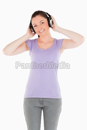 good looking woman posing with headphones