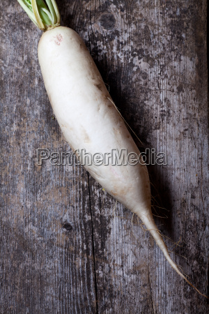 radish on a wooden board