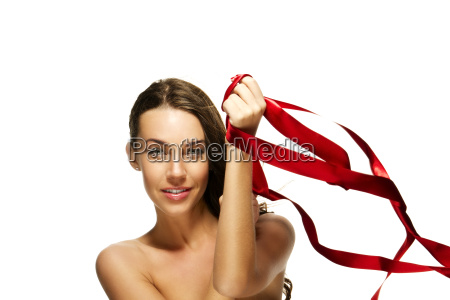 beautiful woman playing with red ribbon