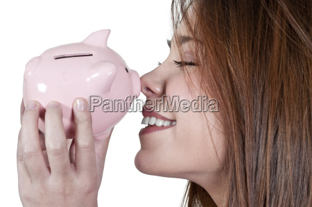 kvinde der holder piggy bank