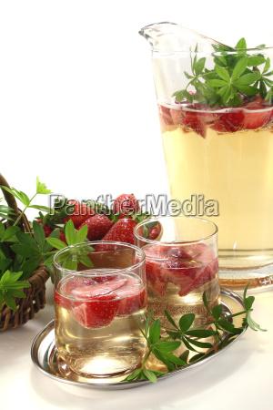 maibowle with strawberries and woodruff