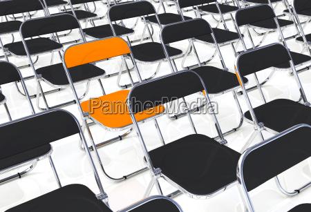 en klapstol i partiet af sort
