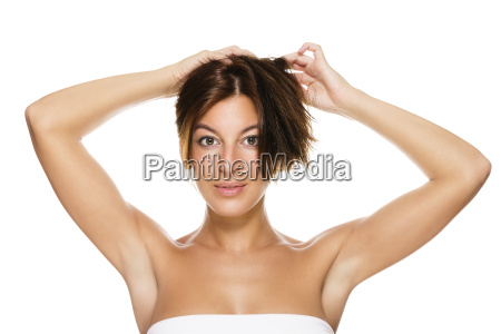 young beautiful woman holding her hair