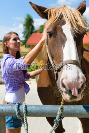 young woman in the barn or