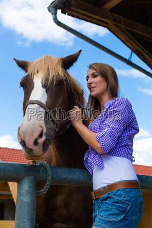 young woman in the barn with