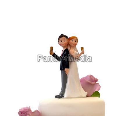 bryllupskage med brud og brudgom