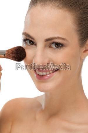 ung kvinde far makeup makeup pulver