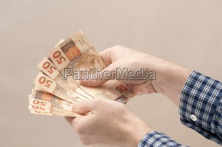 hand haender betalingsmiddel montfod valuta bors