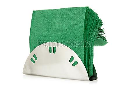 bord serviet holder med gronne servietter