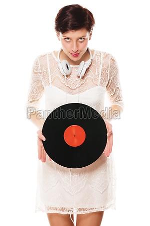 young veschmitze woman holds soundplate