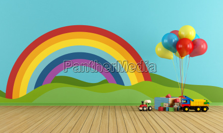 tomt playroom med regnbue og legetoj