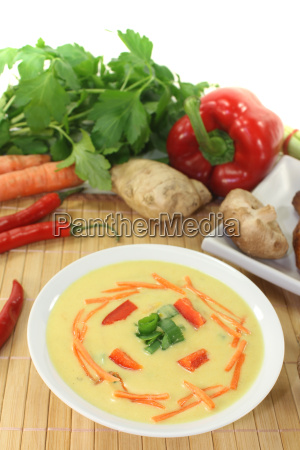 curry soup with chicken and carrots