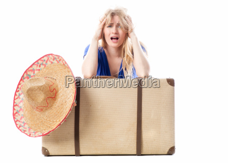 blond girl sitting behind a travel