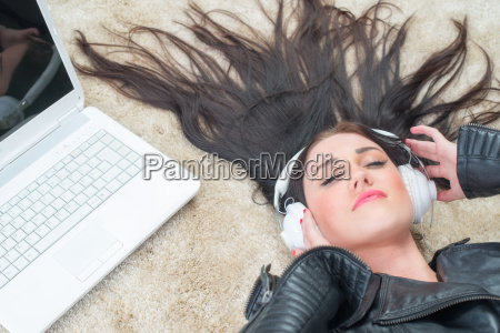 young woman lying on the carpet