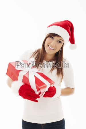 beautiful woman with santa hat holding