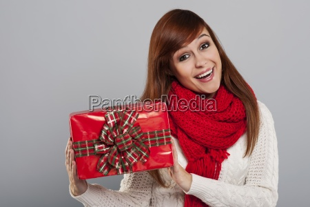 smiling woman in warm clothes holding