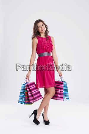 happy young female holding shopping bags