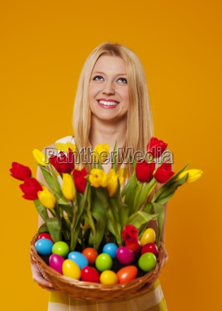 happy woman holding basket with spring