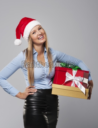 business mrs claus with stack of