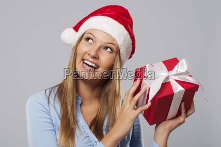 happy blonde woman holding small red