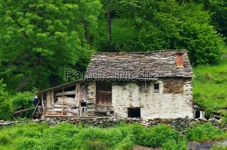 hus bygning sten alper stenmasse stenlag