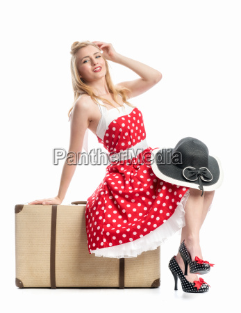 pinup girl sitting on suitcase