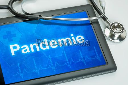tablet med tekst pandemien pa displayet