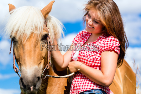 woman riding on horse in summer