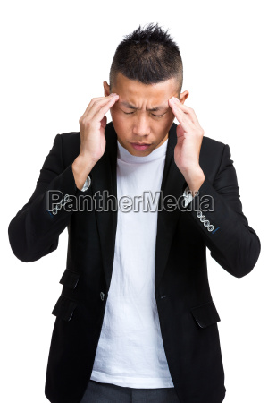 business mand med alvorlig hovedpine
