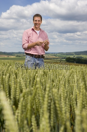 portrait of smiling farmer standing in