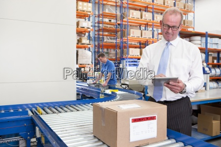 supervisor using digital tablet next to