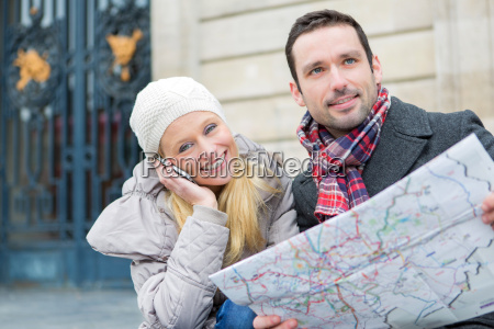 couple of young attractive tourist watching