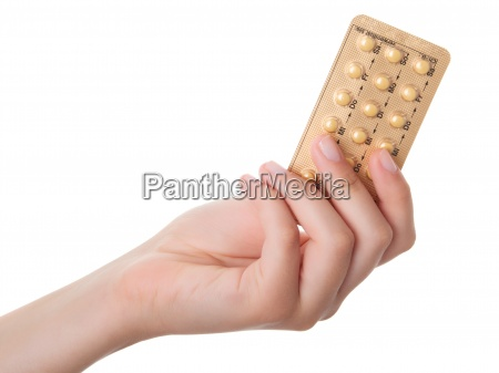 tabletter p piller i handen isoleret
