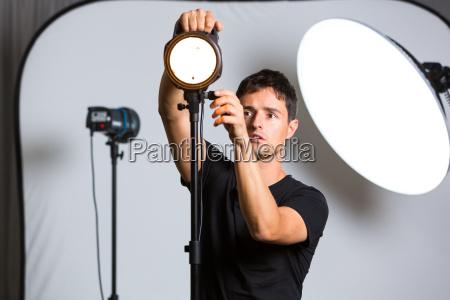 kvindelig kamera fotoapparat fotografiapparat stillkamera studio