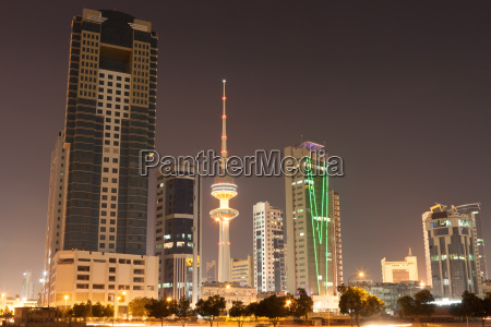 skyline of kuwait city illuminated at