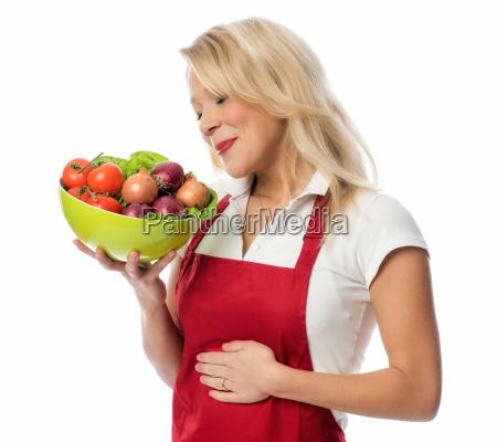 housewife med forklaede holder en laekker