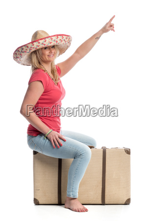 a woman sitting on a suitcase