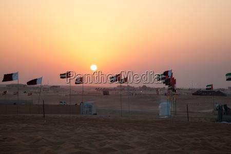 sunset in the desert of madinat