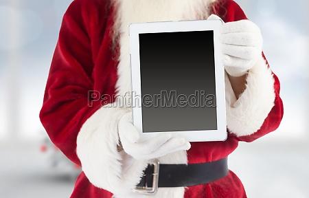 sammensat billede af julemanden viser tablet