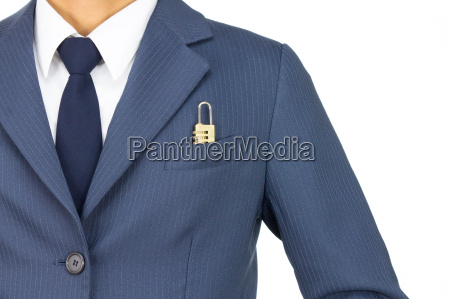businessman and combination lock in pocket