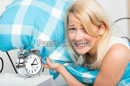 young woman lying sleepless in bed