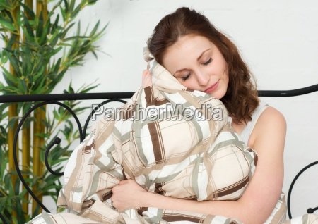 young woman snuggles up in the