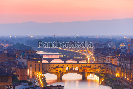 arno and ponte vecchio at sunset