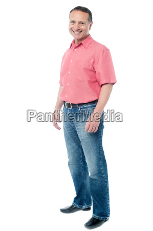 casual aged man standing over white