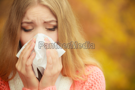 sick ill woman in autumn park