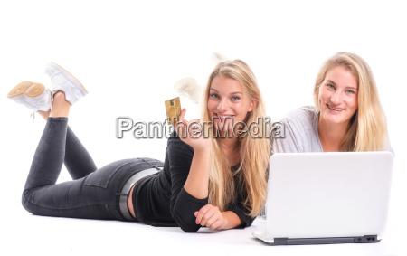 2 blonde young girl when shopping